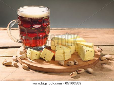 beer with snacks on wood