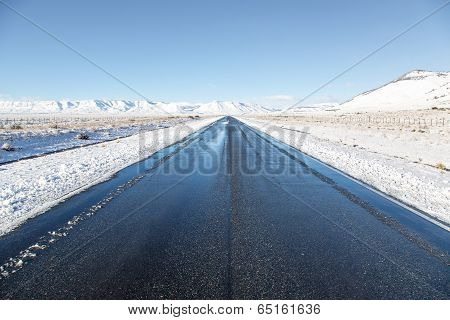 Empty road surrounded by snow in El Calafate, Patagonia Argentina
