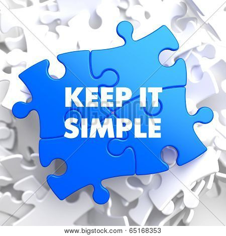 Keep It Simple Concept on Blue Puzzle.