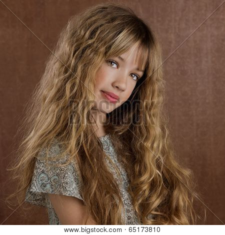 Blond kid girl curly hair portrait on retro vintage brown background