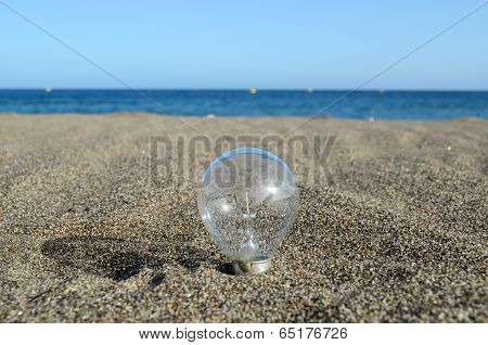 Light bulb on the beach