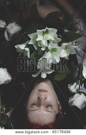 Innocence, Teen submerged in water with white roses, romance scene