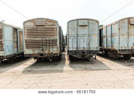 Grey Cargo Train Carriage In Train Yard