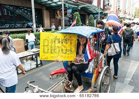 Bangkok - February 2: Unidentified Woman Riding Tricycle For Thailand's Protest Against The Governme