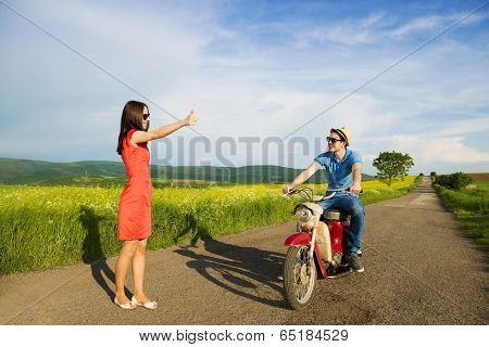 Couple with motorbike