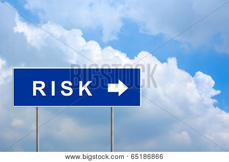 Financial Risk On Green Road Sign