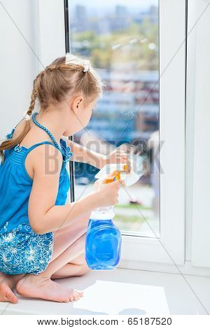Washing Windows With A Rag And Spray, Small Girl In Blue Dress