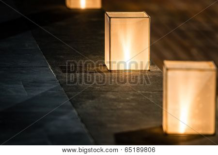 Square Lanterns With Dim Light On Street.