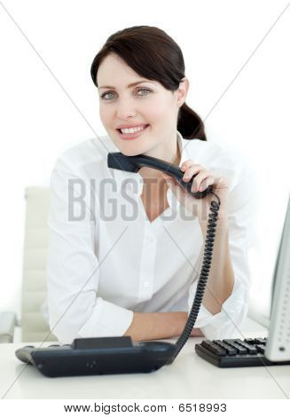 Portrait Of A Smiling Businesswoman Holding A Phone
