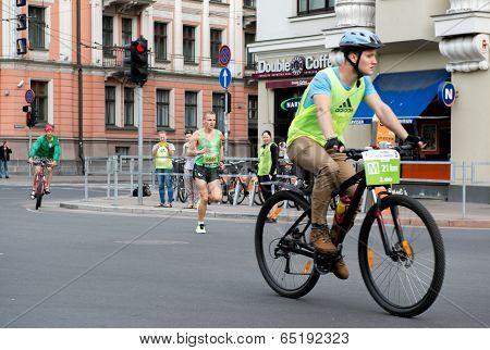 Latvia, Riga- 18 May, 2014: Competitors During The 2014 Nordea Riga Marathon. Previous Marathon On M