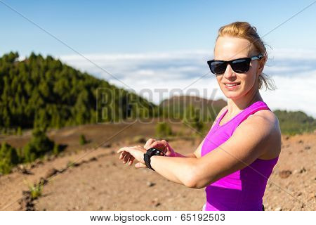 Woman Trail Runner Looking At Sport Watch