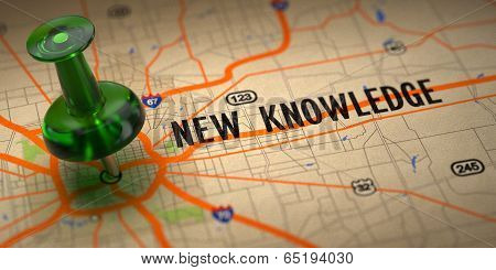 New Knowledge  - Green Pushpin on a Map Background