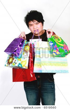 Asian Teen Boy With Shopping Bags