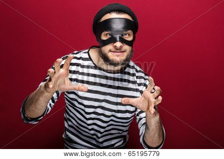 Masked criminal ready to fight