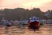 stock photo of lobster boat  - Fishing boats at sunset in Perkins Cove - JPG