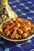 image of tagine  - Moroccan hot harissa olives in a tagine - JPG