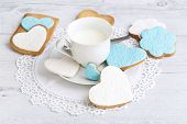 foto of sugar paste  - Shortbread cookies in the shape of heart decorated with sugar paste - JPG