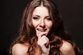 stock photo of nibbling  - pretty young woman nibbling the bar of chocolate - JPG