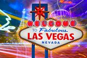 stock photo of nightfall  - Welcome to Fabulous Las Vegas sign sunset with Strip background Nevada photo mount - JPG