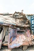 stock photo of railroad yard  - A wreckage of passenger train from train yard on a sunny day - JPG
