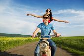 Постер, плакат: Couple on motorbike