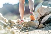 stock photo of dirt road  - Walking or running legs on trail adventure and exercising in mountains nature runners sports shoe on dirt road - JPG