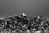 image of scrap-iron  - Industrial shavings with a drill on it - JPG