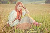 pic of hippy  - Country hippie girl sitting at golden field
