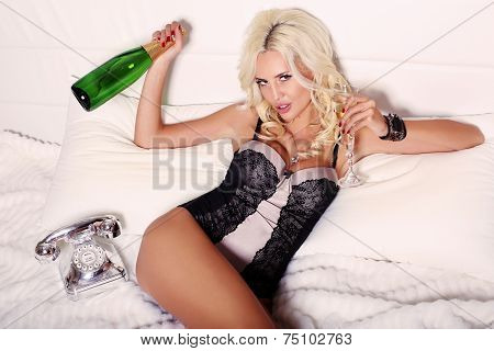 Sexy Woman With Blond Hair With Glass And Bottle Of Champagne
