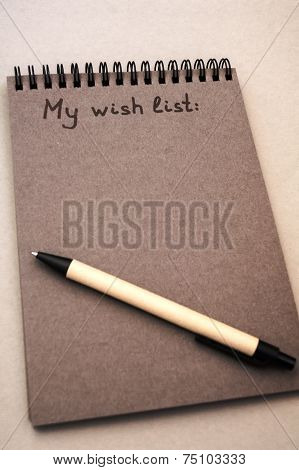 Hand Drawing Wish List On Grey Notebook
