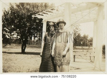 CANADA - CIRCA 1920s: Vintage photo shows  two young women in the park.