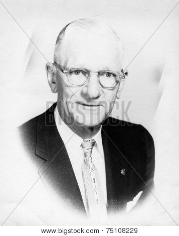 CANADA - CIRCA 1940s: Vintage photo shows Portrait of elderly businessman.