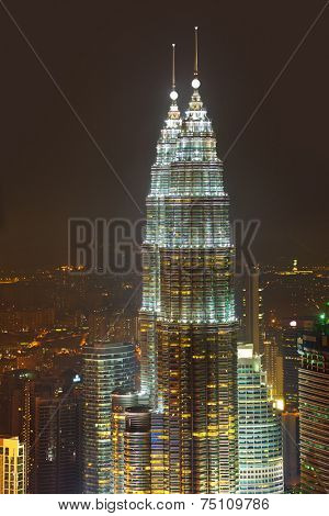 KUALA-LUMPUR, MALAYSIA - APRIL 08: Twin towers Petronas at night April 08, 2011, Kuala Lumpur, Malaysia.
