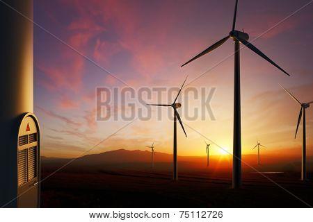 Wind Turbine farm with moody sunset (focused on nearest turbine on right)