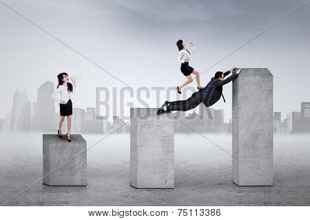 Business Leader Shouting To Her Workers