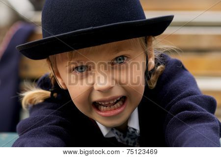 Close-up Of Little Girl Pretending To Growl
