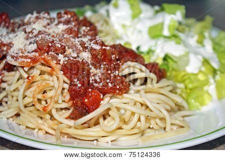 Spaghetti With Meat Sauce And Grated Parmesan Cheese