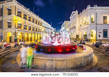 MACAU, CHINA - MAY 21, 2014: People enjoy Senado Square. The territory was the last European colony in Asia and the architecture is inspired by the former Portuguese rule.