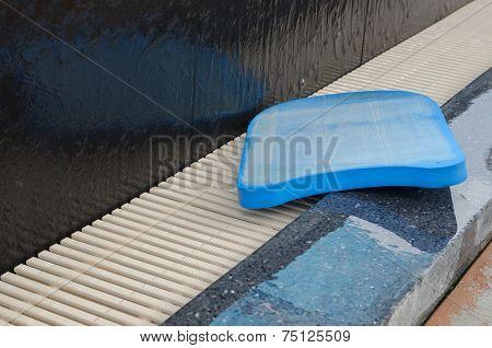 Blue Foam Board  Beside Swimming Pool