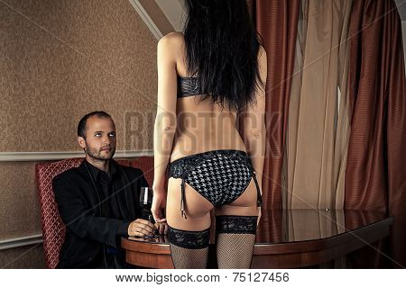 woman in lingerie standing in front the boss