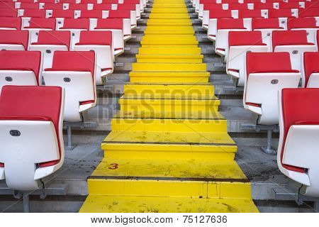 Tribunes, steps and chairs at stadium