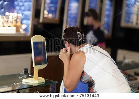 Girl Trying On Earrings