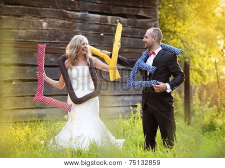Bride and groom having fun outside