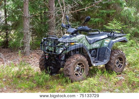 Borovichi, Russia - July 3, 2014: Quad Bike At The Forest In Summertime