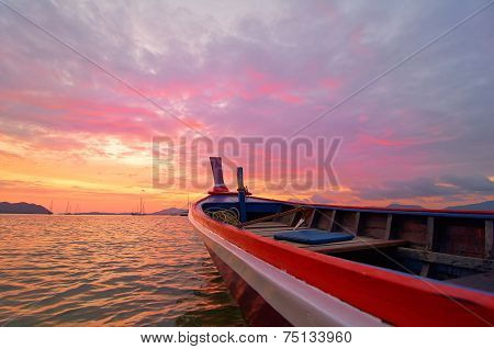 Beautiful sunrise in Phuket island Thailand with Long tail boat