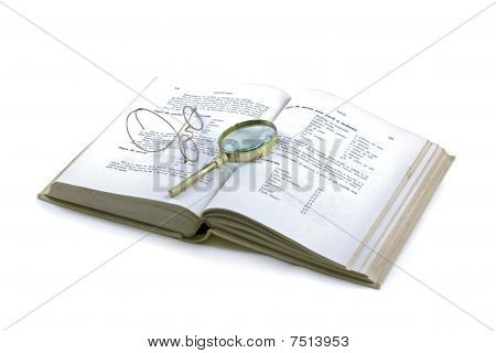 Book,glasses And Magnifying Glass Isolated On White