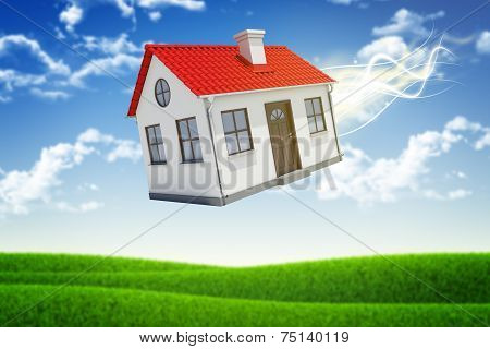 House is falling from the sky. Sky and grass on background