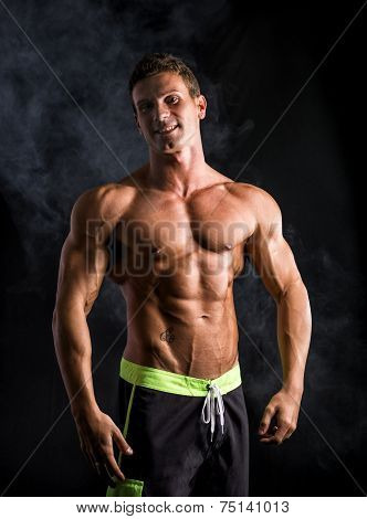 Attractive Shirtless Muscular Man Smiling At Camera
