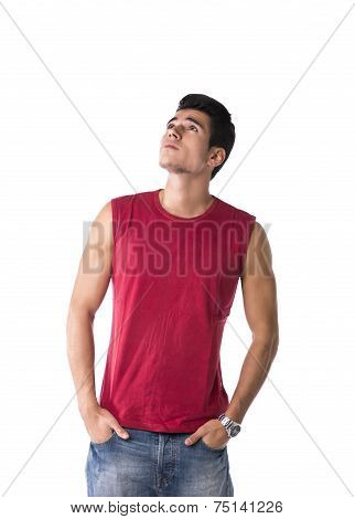 Attractive Young Man In Red Tanktop And Jeans, Looking Up