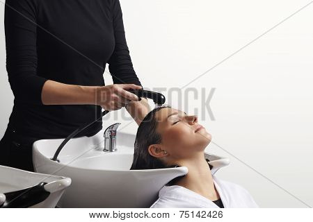 Hair Treatment In Salon, Hairdresser Washing Client's Hair